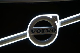 In front of the electric bus a new back-lit Volvo brand iron mark finds it place